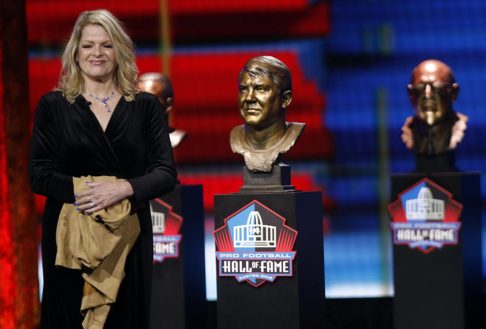 """FILE - Carolyn Karras smiles after unveiling the bust of her father Alex Karras at the Pro Football Hall of Fame Enshrinement ceremony in Canton, Ohio, in this Wednesday, April 28, 2021, file photo. For all the acclaim that followed, Karras died at age 77 in 2012 without one of the honors he coveted most: a bust in the Pro Football Hall of Fame. """"He believed in fairness and he said what needed to be said, whether it was appropriate or not,"""" Carolyn Karras said. """"And I'm not sure how, but I got this picture of him going into the Hall stuck in my head. So I started finding out who the voters were. Two or three got back to me early on and were a great help.(Tom E. Puskar/AP Images for NFL, File)"""