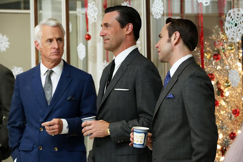 """This publicity image released by AMC shows John Slattery as Roger Sterling, left, Jon Hamm as Don Draper, center, and Vincent Kartheiser as Pete Campbell in a scene from the season six premiere of """"Mad Men,"""" airing Sunday, April 7, on AMC. (AP Photo/AMC, Michael Yarish)"""