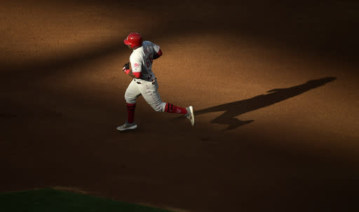 Cincinnati Reds' Yasiel Puig rounds second after hitting a solo home run during the fifth inning of a baseball game against the Los Angeles Angels Wednesday, June 26, 2019, in Anaheim, Calif. (AP Photo/Mark J. Terrill)