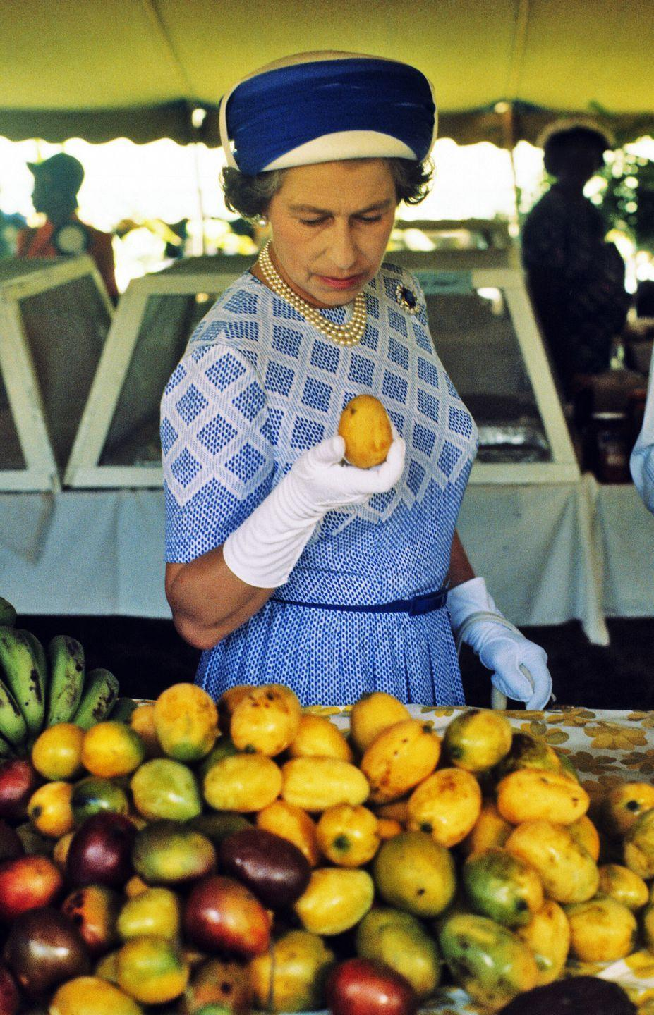 <p>In October 1977, the Queen made a royal trip to the British Virgin Islands, where she had a chance to tour a market. Of course she went straight for the mangos, which are notoriously a favorite food of Her Majesty—she even travels with Bilawal House mangos.</p>