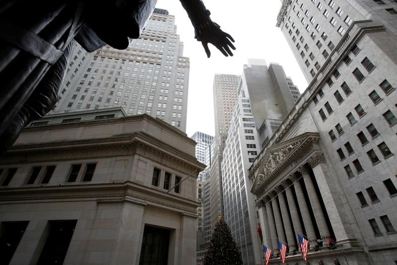 FILE PHOTO: A statue of George Washington stands across from the New York Stock Exchange in Manhattan, New York City