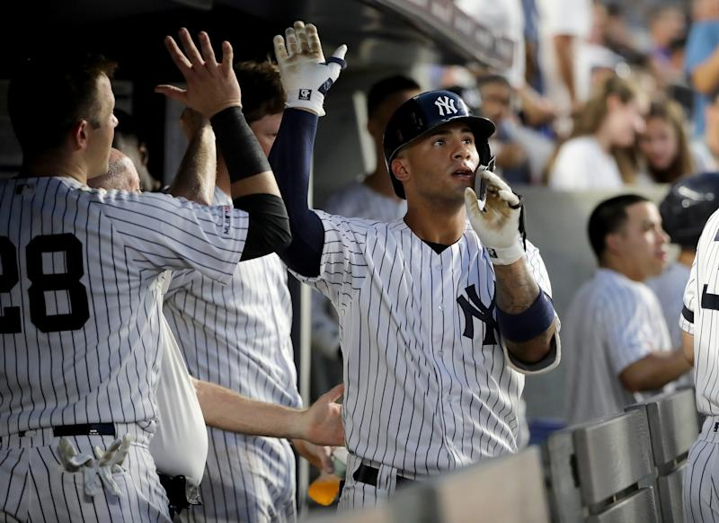 NEW YORK, NEW YORK - AUGUST 03: Gleyber Torres #25 of the New York Yankees celebrates his solo home run in the third inning against the Boston Red Sox during game two of a double header at Yankee Stadium on August 03, 2019 in New York City. (Photo by Elsa/Getty Images)