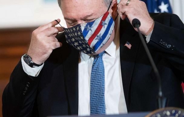 PHOTO: Secretary of State Mike Pompeo puts on his mask after speaking to the press prior to meeting with Kuwaiti Foreign Minister Sheikh Ahmad Nasser Al-Mohammad Al-Sabah at the State Department in Washington, Nov. 24, 2020. (Saul Loeb/Pool/AFP via Getty Images, FILE)