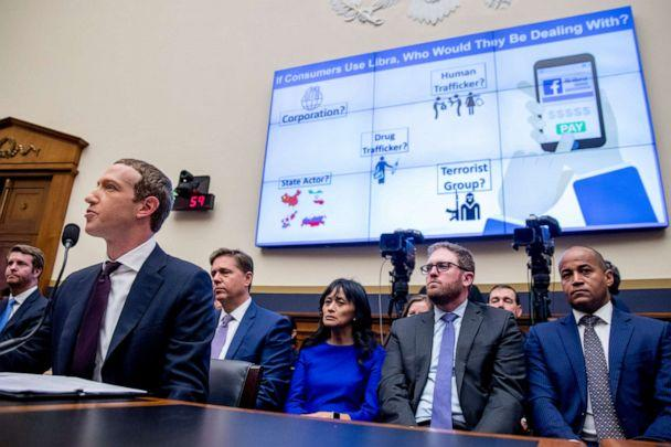 PHOTO: A graphic is displayed on a monitor behind Facebook CEO Mark Zuckerberg as he testifies before a House Financial Services Committee hearing on Capitol Hill in Washington, Oct. 23, 2019. (Andrew Harnik/AP)