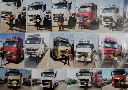 Pictures show customers with their new liquefied natural gas (LNG) trucks at a heavy-duty truck shop in Yutian county, China's Hebei province September 29, 2017. REUTERS/Jason Lee