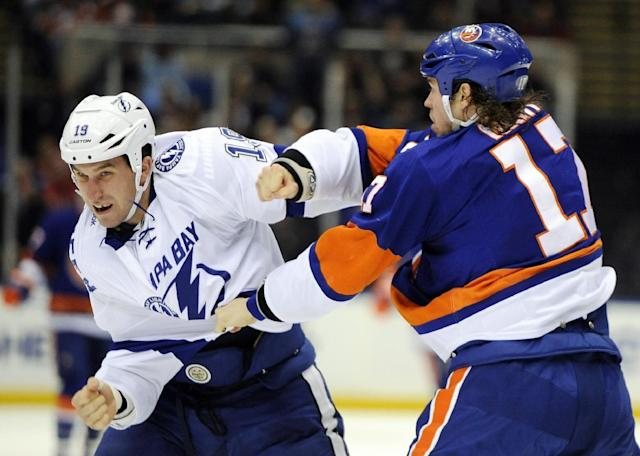 Tampa Bay Lightning' B.J. Crombeen (19) and New York Islanders' Matt Martin (17) exchange punches on the ice in the second period of an NHL hockey game on Tuesday, Dec. 17, 2013, in Uniondale, N.Y. (AP Photo/Kathy Kmonicek)