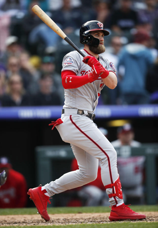 Washington Nationals' Bryce Harper follows the flight of his double off Colorado Rockies relief pitcher Chris Rusin in the ninth inning of a baseball game Sunday, Sept. 30, 2018, in Denver. The Rockies won 12-0. (AP Photo/David Zalubowski)