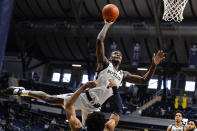 Butler guard Bo Hodges (1) is fouled as he shoots by Villanova forward Jermaine Samuels (23) in the second half of an NCAA college basketball game in Indianapolis, Sunday, Feb. 28, 2021. (AP Photo/Michael Conroy)