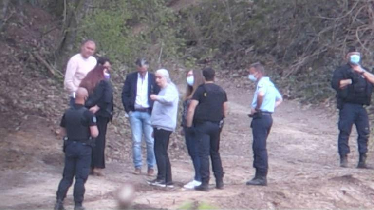 This video grab from AFP TV footage shows the French killer Michel Fourniret's ex-wife Monique Olivier (centre, grey sweatshirt) talking with investigators during the search for the remains of nine-year-old Estelle Mouzin