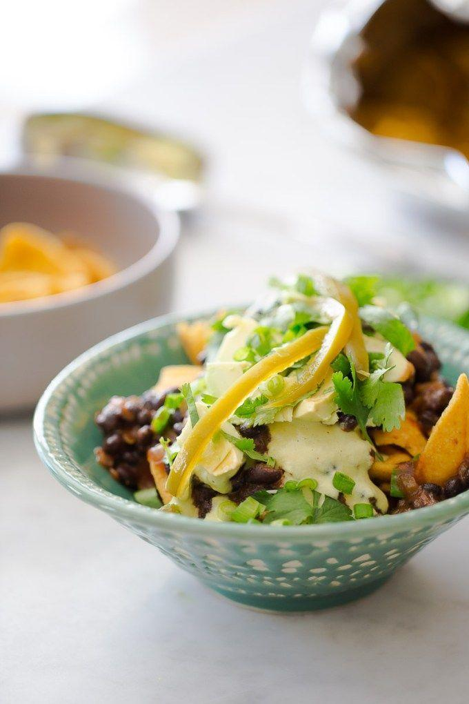"""<p>Whether you're entertaining for a big game or summer barbecue, this hearty crowd-pleaser uses only plant-based ingredients for maximum flavor, like black beans, pickled jalapeños, avocado and poblano peppers. Can't forget the chips!</p><p><a class=""""link rapid-noclick-resp"""" href=""""https://www.brownsugarandvanilla.com/vegan-frito-pie/"""" rel=""""nofollow noopener"""" target=""""_blank"""" data-ylk=""""slk:GET THE RECIPE"""">GET THE RECIPE</a></p><p><em>Per serving: 318 calories, 15 g fat (3 g saturated), 602 mg sodium, 37 g carbs, 11 g fiber, 13 g protein</em></p>"""