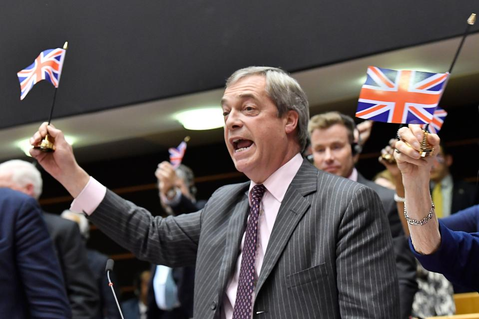 Britain's Brexit Party leader Nigel Farage holds a union flag during a European Parliament plenary session in Brussels on January 29, 2020, as Brexit Day is to be set in stone when the European Parliament casts a vote ratifying the terms of Britain's divorce deal from the EU. (Photo by JOHN THYS / AFP) (Photo by JOHN THYS/AFP via Getty Images)