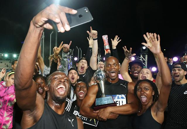 <p>Usain Bolt, Asafa Powell and Usain Bolt's All-Star team celebrate with the trophy after winning the event during the Melbourne Nitro Athletics Series at Lakeside Stadium </p>