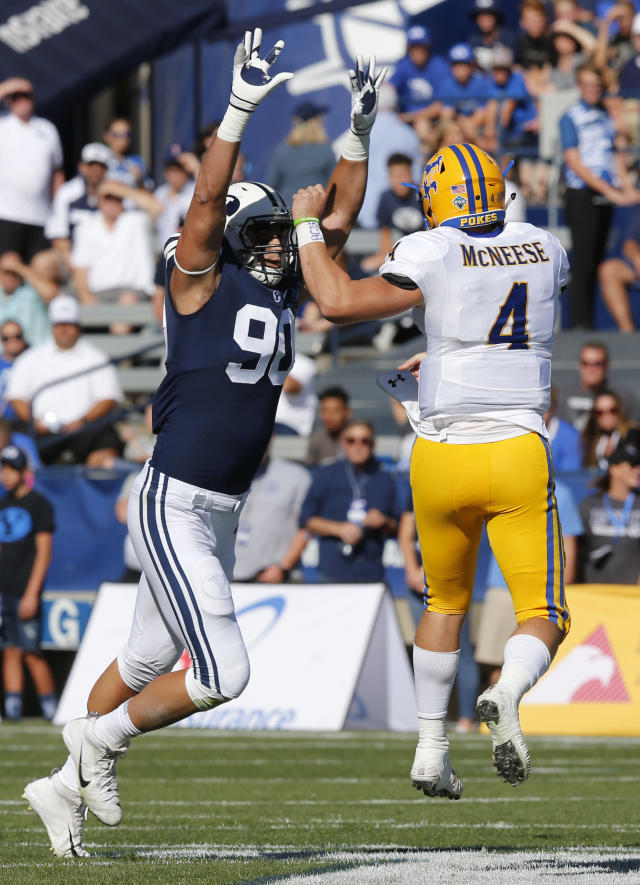 BYU defensive lineman Corbin Kaufusi (90) rushes the pass of McNeese State quarterback James Tabary (4) in the first half during an NCAA college football game Saturday, Sept. 22, 2018, in Provo, Utah. (AP Photo/Rick Bowmer)