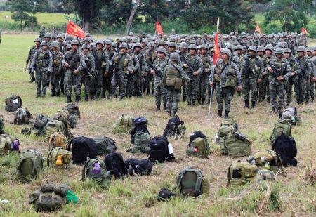 Members of the Philippine Marine Battalion Landing Team (MBLT) and Marine Special Operation Group (MARSOG) stands at attention in front of their belongings during their send-off ceremony inside the military headquarters in Marawi city