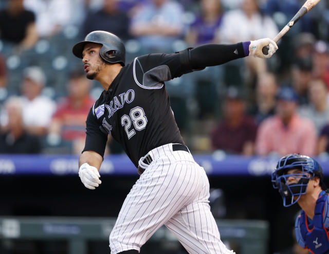 Colorado Rockies' Nolan Arenado follows the flight of his solo home run off New York Mets starting pitcher Seth Lugo during the first inning of a baseball game Wednesday, June 20, 2018, in Denver. (AP Photo/David Zalubowski)