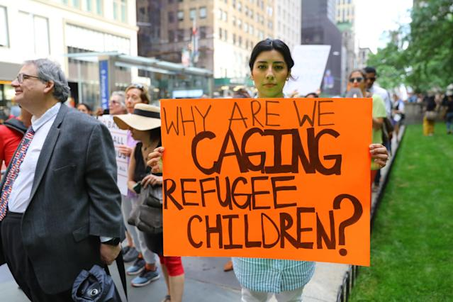 <p>A protester holds a sign protesting the U.S. policy of separating immigrant families on the terrace outside the New York Public Library on 42nd Street in New York City on June 20, 2018. (Photo: Gordon Donovan/Yahoo News) </p>