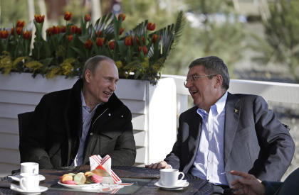 Vladimir Putin, left, and IOC President Thomas Bach sit at a cafe near the Olympic Park in Sochi. (AP)
