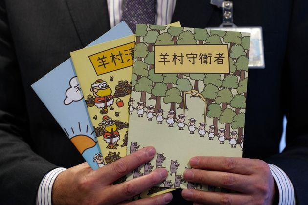 Hong Kong's senior superintendent Steve Li, from the city's new national security police unit, holds children's books which allegedly try to explain about the city's democracy movement, at a police press conference in Hong Kong on July 22, 2021, after five members of a pro-democracy Hong Kong union were arrested for sedition for publishing the titles. (Photo by Daniel SUEN / AFP) (Photo by DANIEL SUEN/AFP via Getty Images) (Photo: DANIEL SUEN via Getty Images)