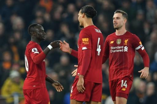 Sadio Mane (left) celebrates the only goal as Liverpool beat Wolves 1-0