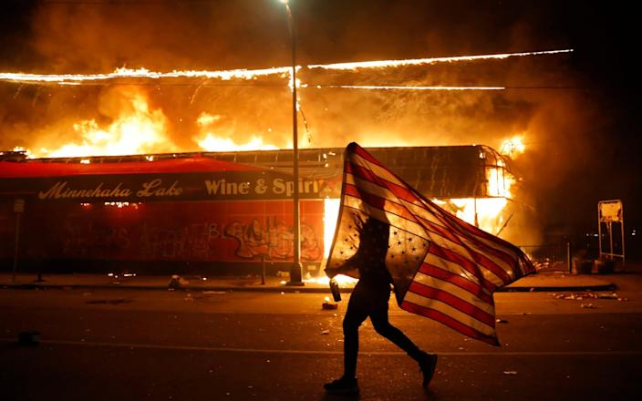 More than 100 Minneapolis officers last year, when the city was rocked by violent protests - Julio Cortez/AP