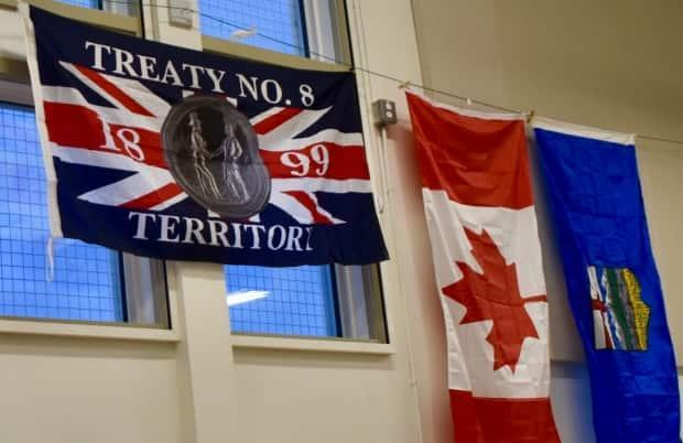 The Treaty 8 flag hangs in a community centre in Fort Chipewyan, Alta. First Nations leaders are developing a corridor that could be used to transport commodities and other materials. (Geneviève Normand/Radio-Canada - image credit)