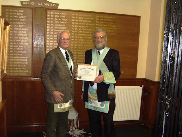 Robb is with his father (left) several years ago after the local Scottish Freemasonry raised over £500,000 for Prostate Scotland. (Supplied)