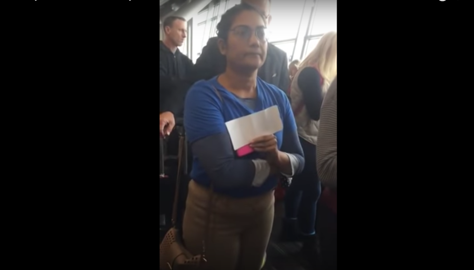 """<span class=""""s1"""">This woman is seen in a video repeatedly telling a fellow passenger to """"sit down.""""</span> (Screenshot: HIMAY10NENCE via YouTube)"""