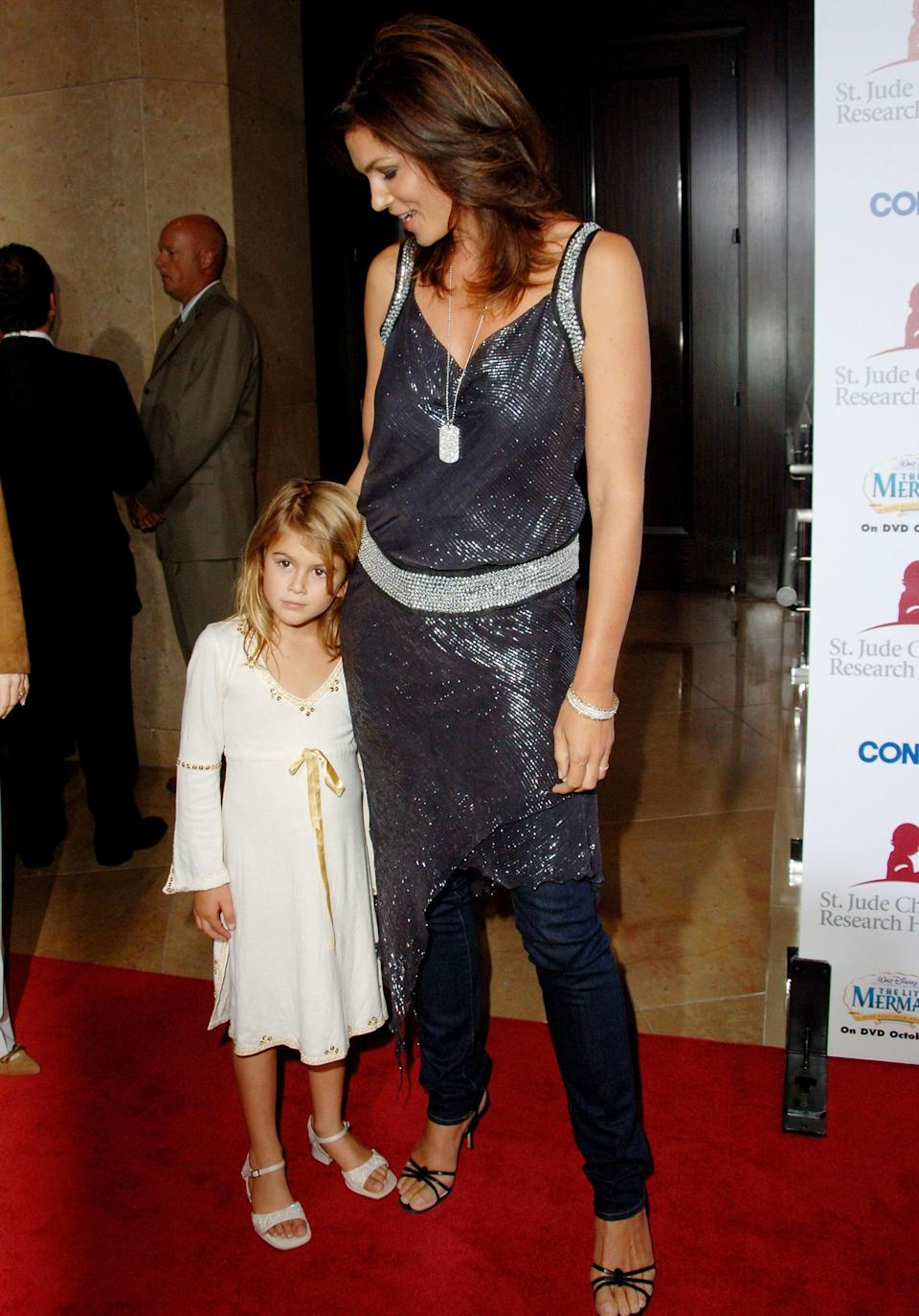 In 2006, Kaia joined her mom for a St. Jude's benefit event. Clad in an embellished white dress and sandals with the tiniest block heel, this was just a glimpse at the stylish teenager she'd become.