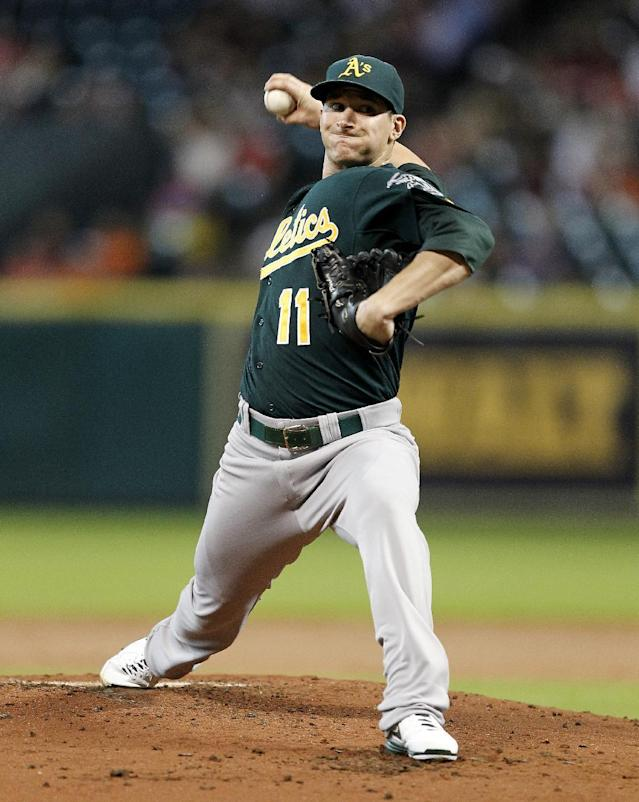 Oakland Athletics' Jarrod Parker throws in the first inning against the Houston Astros during a baseball game on Tuesday, July 23, 2013, in Houston. (AP Photo/Bob Levey)