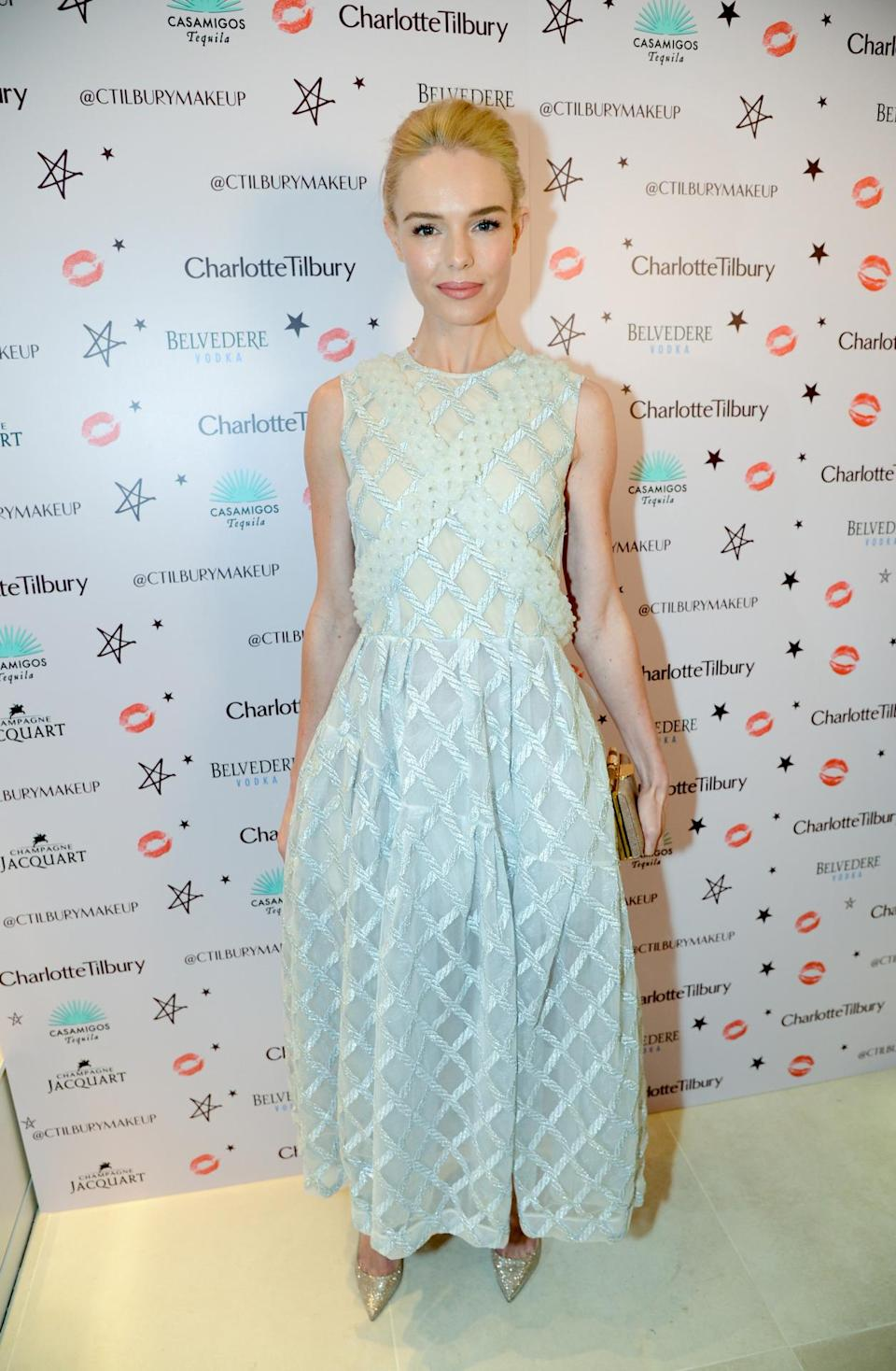 Kate Bosworth looked beautiful in a pale blue Simone Rocha dress, which featured a corseted back and crisscrossed detailing. [Photo: Rex]