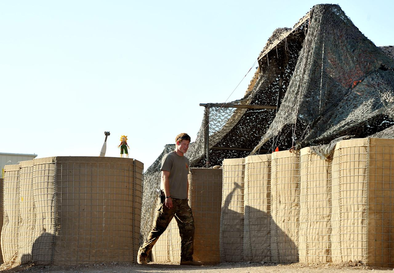 Prince Harry walks to the VHR tent for the start of his 12 hour shift, at Camp Bastion, southern Afghanistan in this photograph taken November 3, 2012. REUTERS/John Stillwell/Pool