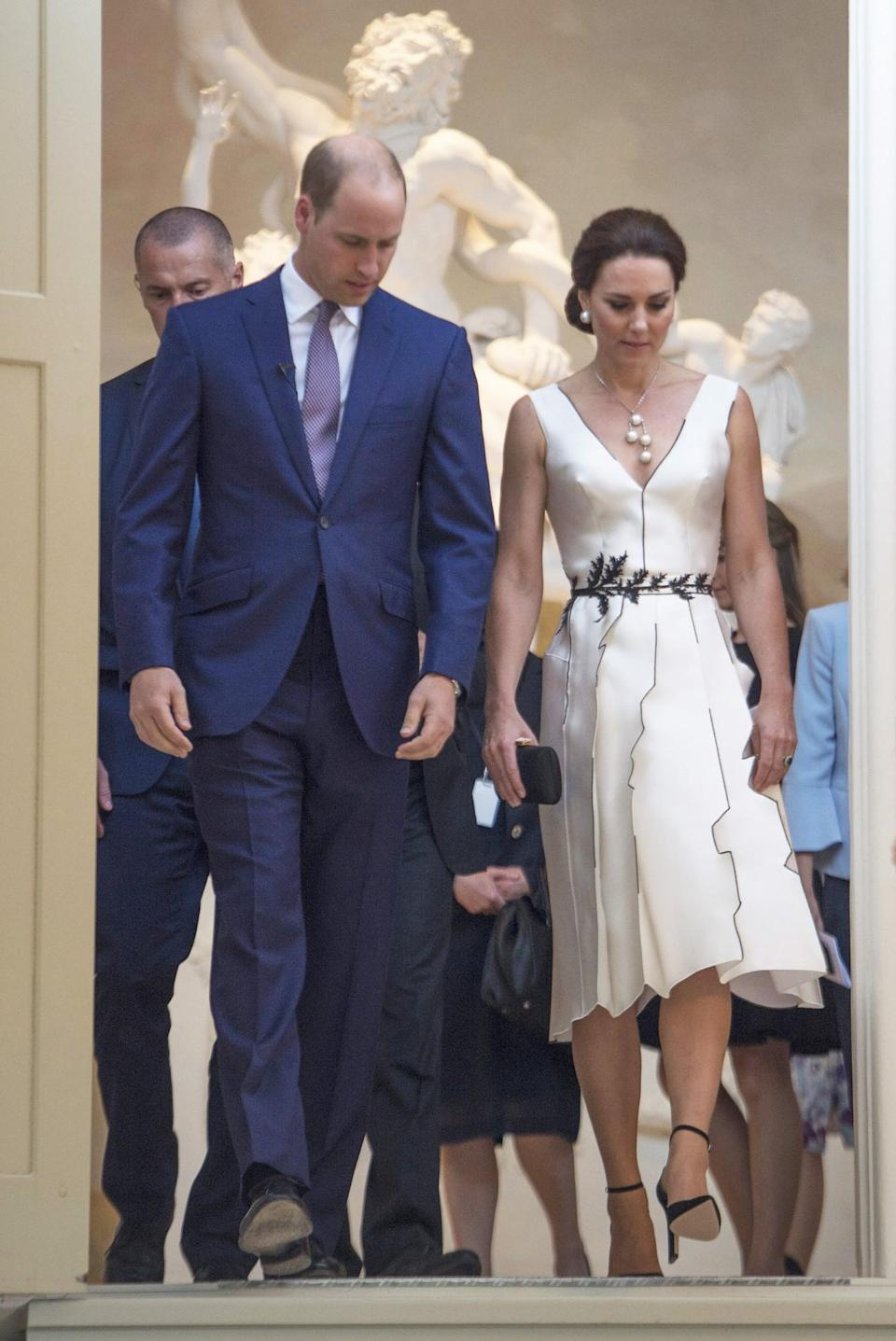 <p><b>Kate's cocktail dress on the first day of her visit to Poland was the brainchild of Polish designer Gosia Baczyńska. <br><em>[Photo: PA]</em> </b></p>