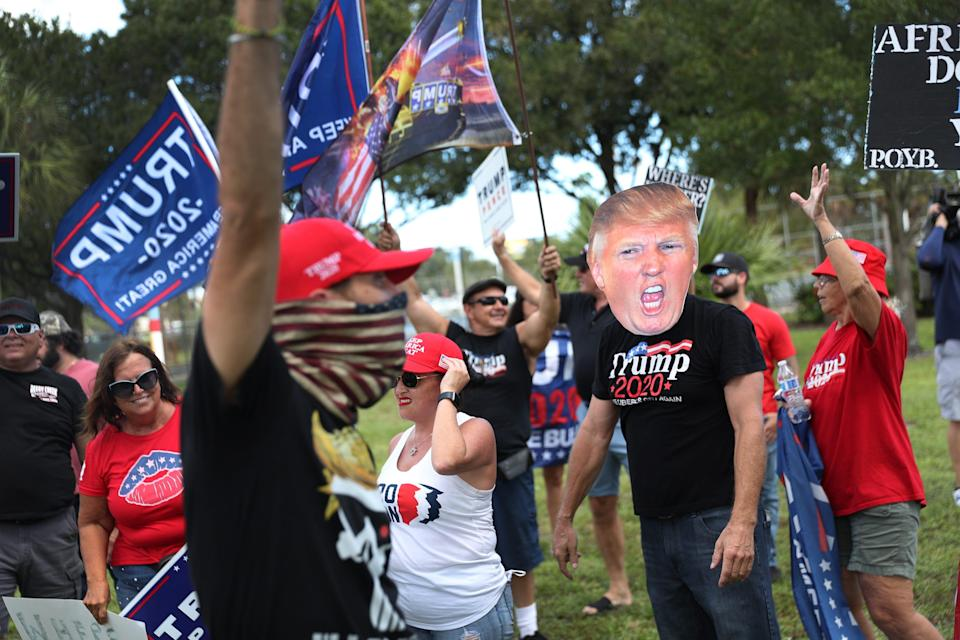 Supporters of President Donald Trump demonstrate outside a Joe Biden campaign rally at the Broward College North Campus on Oct. 29 in Coconut Creek, Fla.
