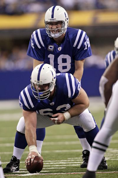 FILE - In this Dec. 27, 2009, file photo, Indianapolis Colts quarterback Peyton Manning (18) gets set behind center Jeff Saturday (63) during the first half of an NFL football game against the New York Jets in Indianapolis. Saturday is torn in choosing sides for Sunday night's showdown between Manning's Broncos and his former team, like other Colts fans, is a struggle. (AP Photo/AJ Mast, File)