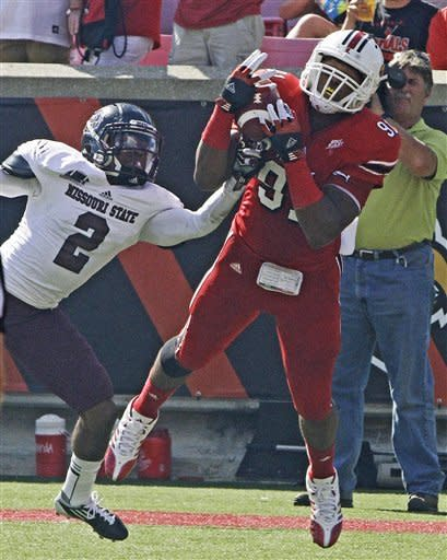 Louisville receiver Marcus Smith (91) makes the catch on a 2-point conversion despite the defensive efforts of Missouri State cornerback Howard Scarborough (2) during the first half of an NCAA college football game in Louisville, Ky., Saturday, Sept. 8, 2012. (AP Photo/Garry Jones)
