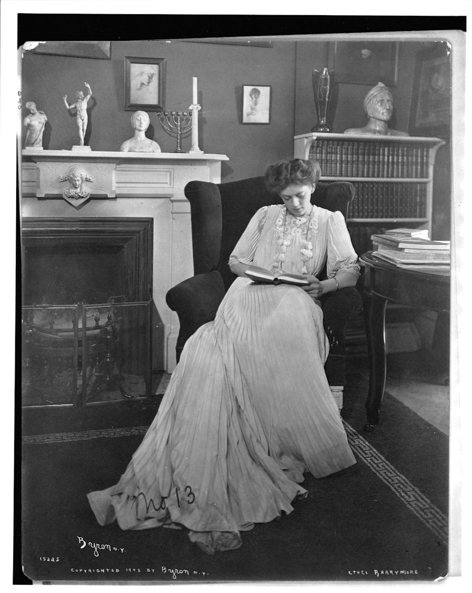 <p>Stage and screen star Ethel Barrymore, great-aunt to Drew Barrymore, reads a book beside a Hanukkah menorah on the fireplace mantel, circa 1910. Ethel made her big-screen debut in 1914's <em>The Nightingale</em>.</p>