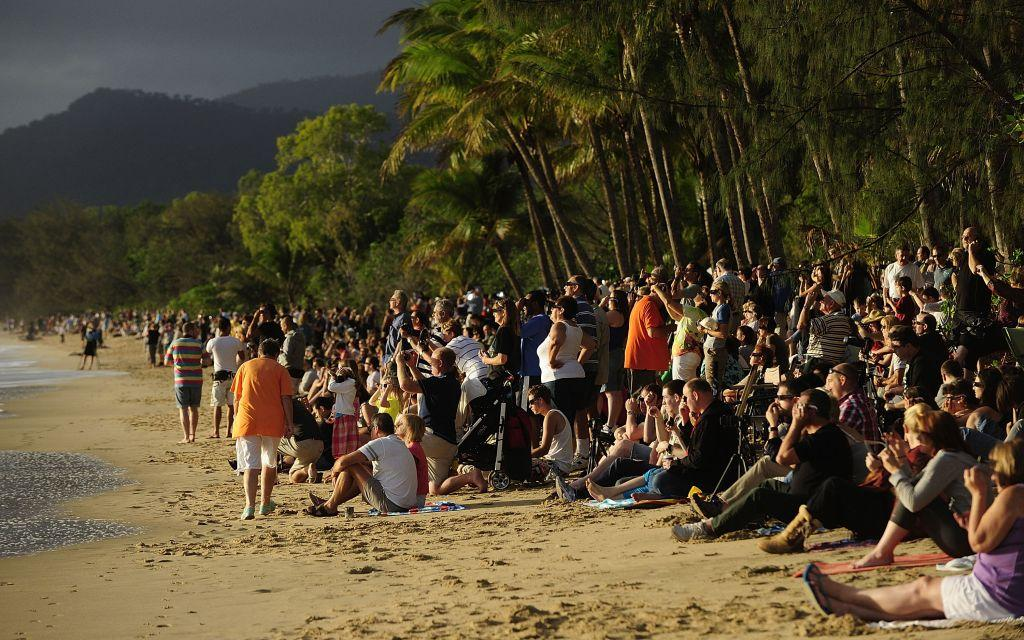 Spectators line the beach to view the total solar eclipse.