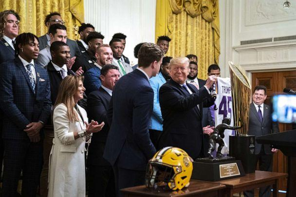 PHOTO: Louisiana State University quarterback Joe Burrow, presents President Donald Trump, with a jersey during an event to honor this year's NCAA football champions LSU Tigers in the East Room of the White House in Washington, Jan. 17, 2020. (Drew Angerer/Getty Images)