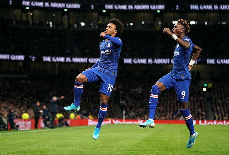 Chelsea's Willian (left) celebrates scoring his side's first goal of the game with team-mate Tammy Abraham Tottenham Hotspur v Chelsea - Premier League - Tottenham Hotspur Stadium 22-12-2019 . (Photo by  John Walton/EMPICS/PA Images via Getty Images)