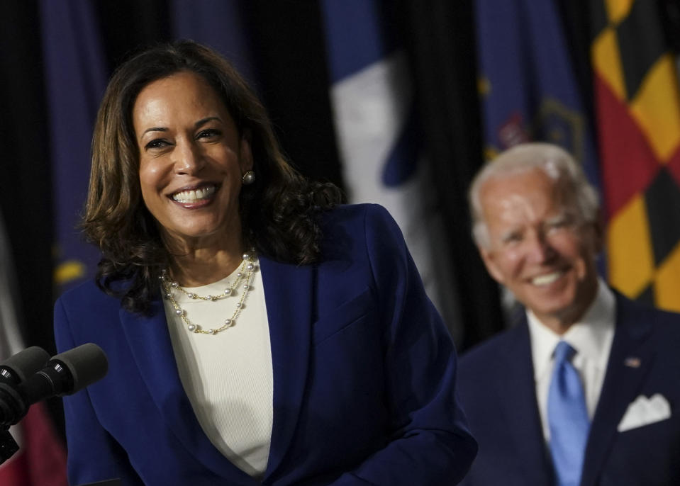 WILMINGTON, DE - AUGUST 12: Sen. Kamala D. Harris (D-Calif.) smiles after being introduced by presumptive Democratic presidential nominee Joe Biden as his running mate during an event at Alexis I. DuPont High School in Wilmington, Del., on Wednesday, Aug. 12, 2020. The former vice presidents historic selection makes Harris the first Black woman and first Asian American to run for vice president on a major-party ticket.   (Photo by Toni L. Sandys/The Washington Post via Getty Images)