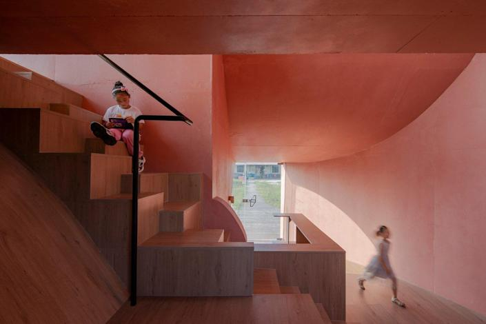 The rosy-colored, simple yet classy interiors of the Atelier XI-designed