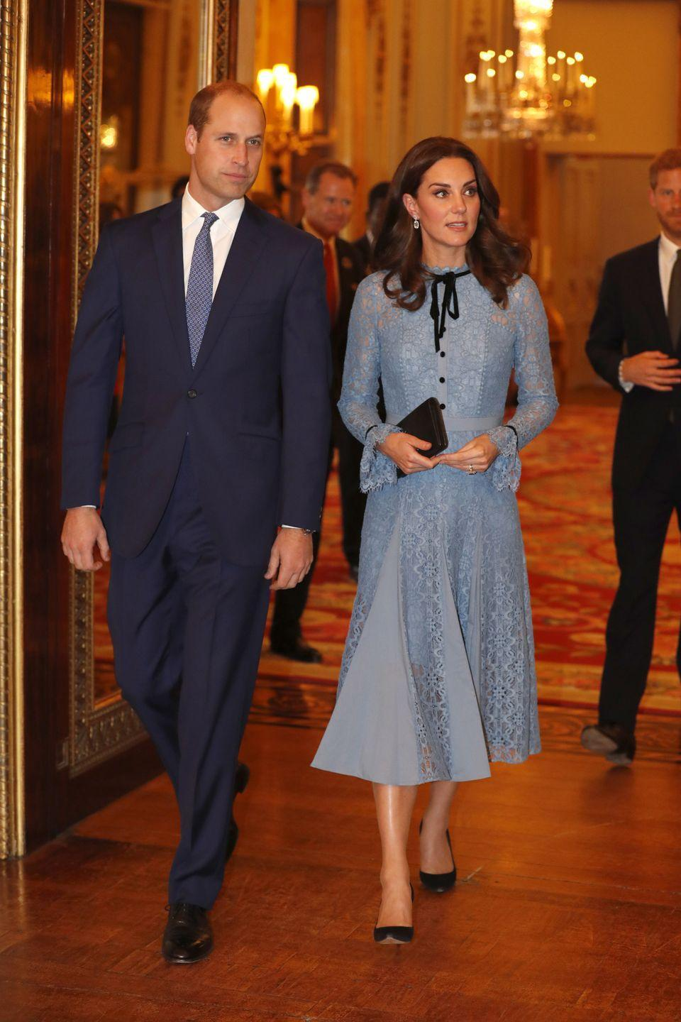 """<p>The Duchess wears a blue lace Temperley London Dress, black pumps, and a clutch at Buckingham Palace for a World Mental Health Day celebration. This marked her <a href=""""https://www.harpersbazaar.com/celebrity/latest/a12816892/kate-middleton-first-appearance-third-pregnancy/"""" rel=""""nofollow noopener"""" target=""""_blank"""" data-ylk=""""slk:first public appearance"""" class=""""link rapid-noclick-resp"""">first public appearance</a> since announcing her third pregnancy.</p>"""