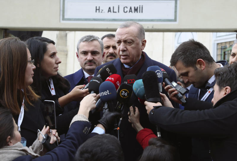 "Turkey's President Recep Tayyip Erdogan speaks to the media after Friday prayers, in Istanbul, Friday, Jan. 17, 2020.  Erdogan expressed doubt that Khalifa Hifter, the head of the self-styled Libyan National Army, would abide by the cease-fire. ""This man is not a trust-worthy man,"" he told reporters in Istanbul, "" yesterday, they continued to bomb Tripoli."" (Presidential Press Service via AP, Pool)"