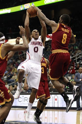 Atlanta Hawks guard Jeff Teague (0) goes up for a shot against Cleveland Cavaliers guard Jeremy Pargo (8) during the first half of an NBA basketball game, Friday, Nov. 30, 2012, in Atlanta. (AP Photo/John Bazemore)