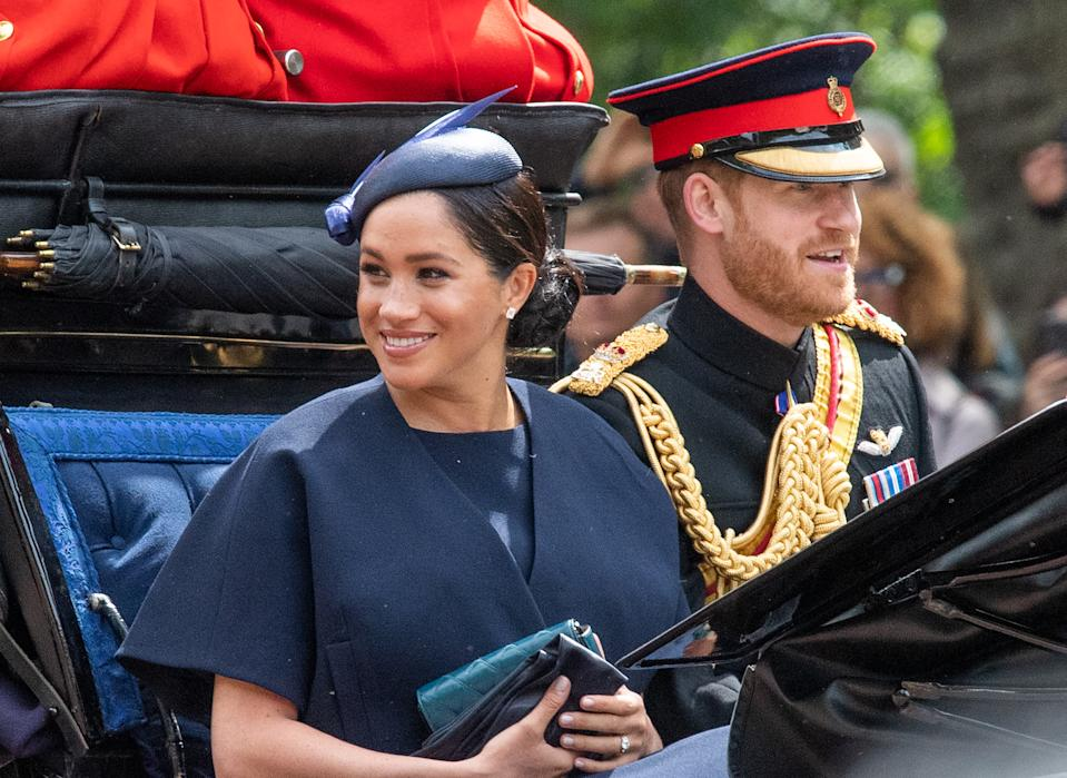 Meghan, Duchess of Sussex rides in an open carriage with Prince Harry, Duke of Sussex during Trooping the Colour in London on June 08, 2019.  This was her first public engagement since the birth of her son Archie.