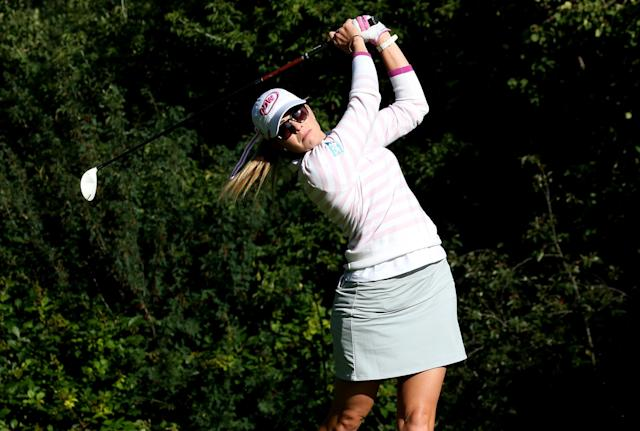 EDMONTON, AB - AUGUST 22: Paula Creamer hits her tee shot on the sixth hole during the CN Canadian Women's Open at Royal Mafair Golf Club on August 22, 2013 in Edmonton, Alberta, Canada. (Photo by Stephen Dunn/Getty Images)