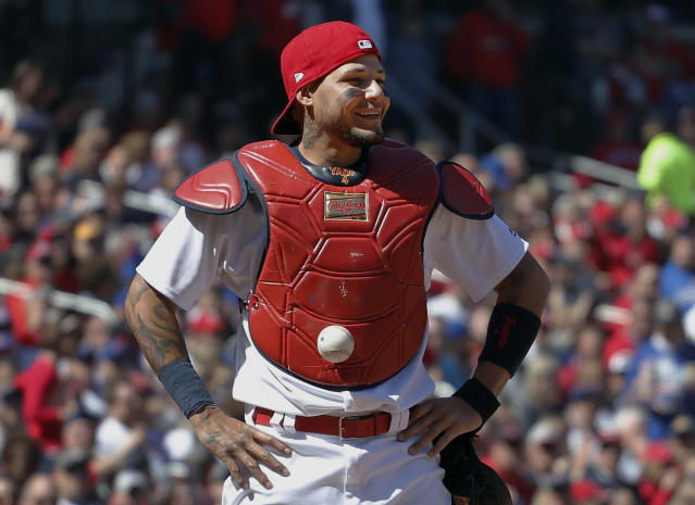 Yadier Molina with the now for-sale ball stuck to his chest protector. (AP)