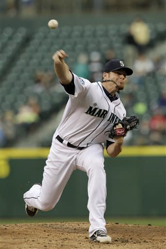 Seattle Mariners starting pitcher Blake Beavan throws to a Texas Rangers batter during the second inning of a baseball game, Saturday, Sept. 22, 2012, in Seattle. (AP Photo/Ted S. Warren)