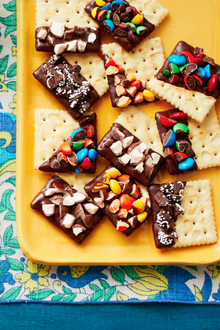 """<p>If you can't decide between a sweet or savory snack, then you'll love these chocolate-dipped, candy-covered crackers. </p><p><strong><em>Get the recipe at <a href=""""https://www.thepioneerwoman.com/food-cooking/recipes/a32129917/concession-stand-crackers-recipe/"""" rel=""""nofollow noopener"""" target=""""_blank"""" data-ylk=""""slk:The Pioneer Woman"""" class=""""link rapid-noclick-resp"""">The Pioneer Woman</a>. </em></strong></p>"""