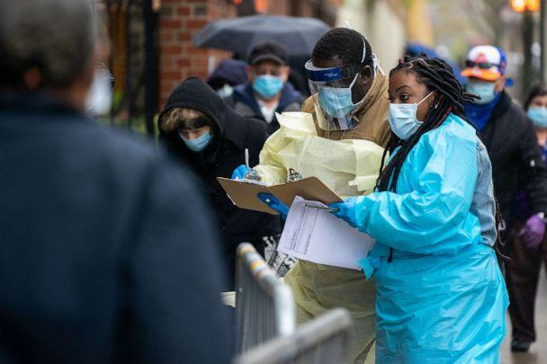 PHOTO: Medical workers assist people standing in line at NYC Health + Hospitals/Gotham Health, waiting to be tested for the coronavirus on April 24, 2020, in New York City. (David Dee Delgado/Getty Images)